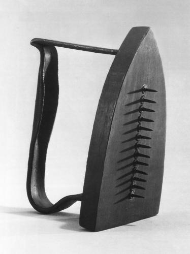 Man Ray, Gift, 1921.