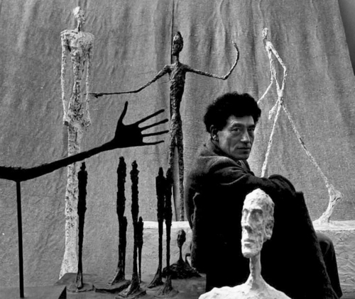 Alberto Giacometti surrounded by his Existentialist-inspired works, 1951.